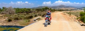 naxos transport panorama 300x110 - Naxos, Greece - 21 May, 2017: Couple Driving Scooter In Summer Day On Naxos Island. Cyclades, Greece